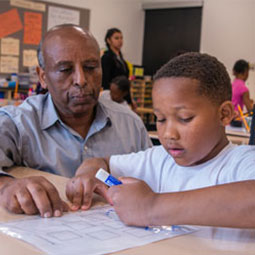 A student and teacher work together in a classroom