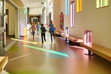 Students in walk down a school hallway