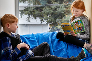 Two students read together.