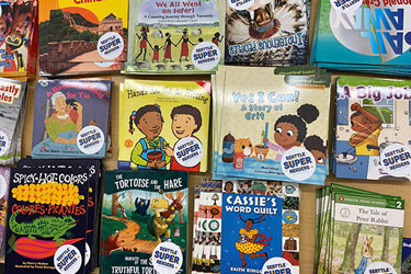 A selection of early reader books on a table.