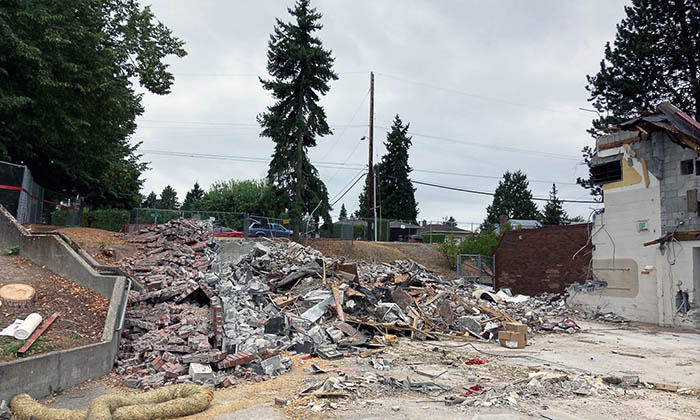 pile of demoltion debris and a part of a building
