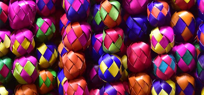 A collection of colorful paper ball banners.
