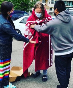 photo of Wes Calf Robe receiving blanket from Boo Balkan Foster and Khemarak (Kam) Pom