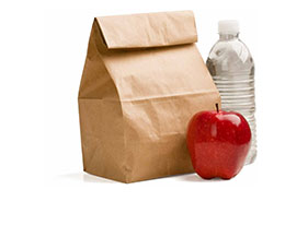 red apple, water bottle, and brown paper bag
